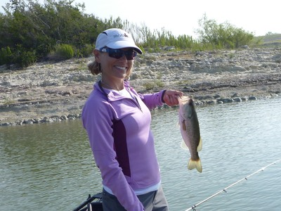 Largemouth bass caught by a woman on Canyon Lake